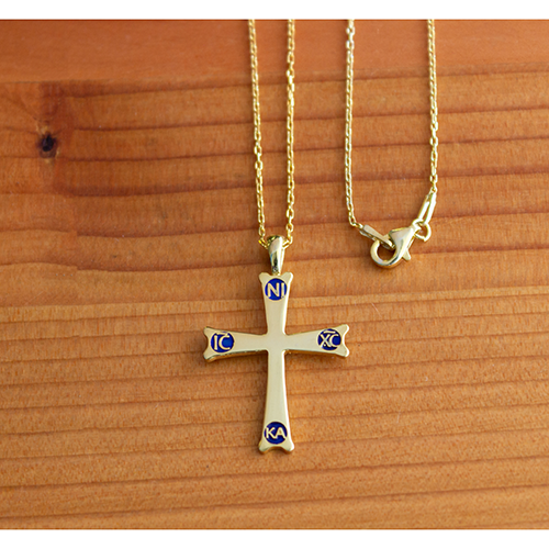 Mount Sinai Cross Gold-Plated Sterling Silver Pendant - 18 Inch Chain on a wooden table