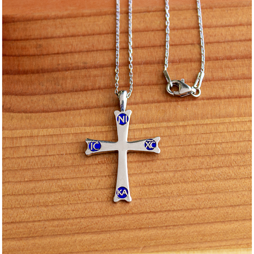 Mount Sinai Cross Sterling Silver Pendant -  18 Inch Chain on a wooden table