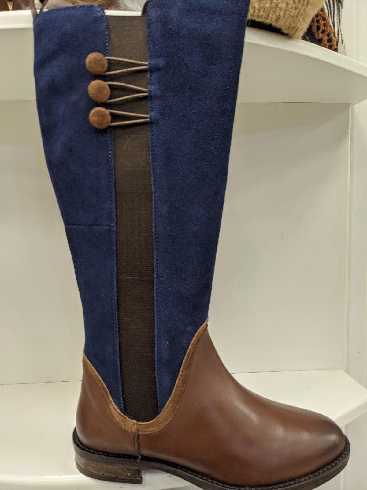 Navy and tan boot