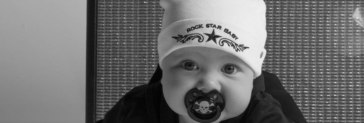 ROCK STAR BABY with white beanie and pirate pacifier