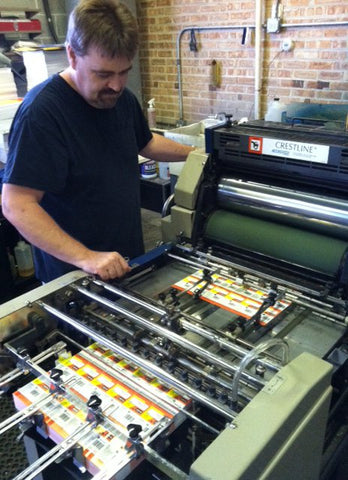 John Halle runs the in-house print shop which makes most of the packaging for DU-BRO