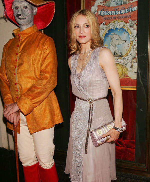 picture of Madonna carrying a Darby Scott embroidered clutch to her children's book launch at Bergdorf Goodman