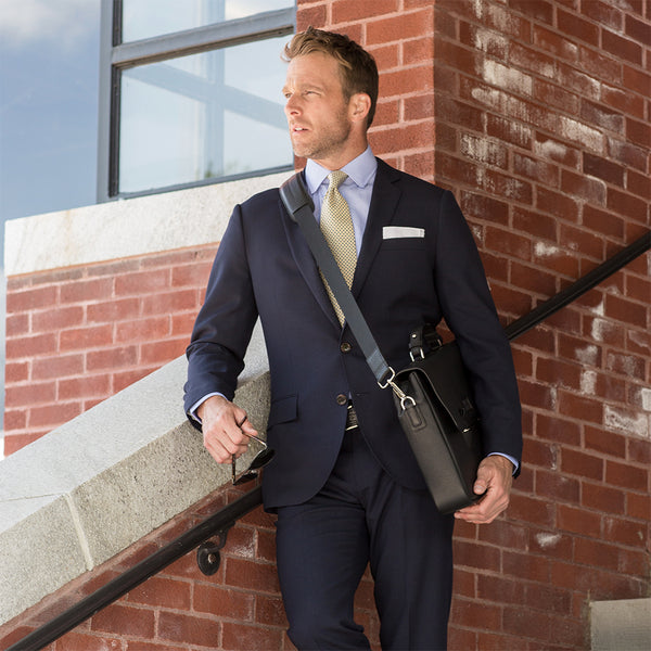 Model In suit with a Darby Scott black leather Penn Messenger bag