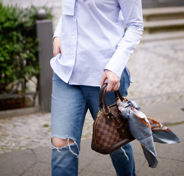 Blogger with handbag and scarf