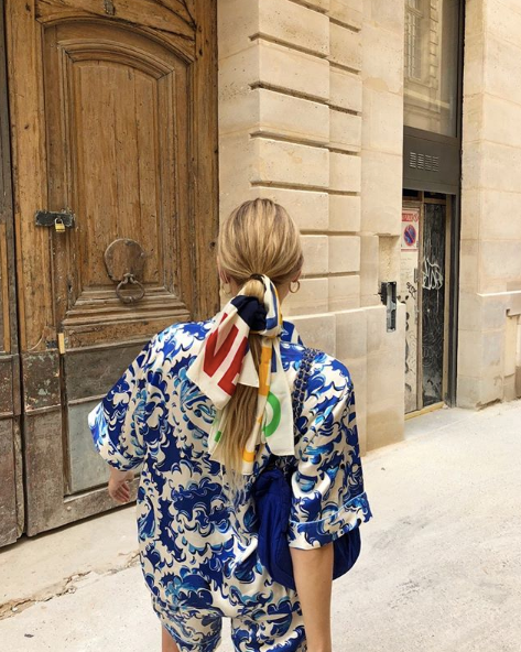 Instagram blogger with silk scarf in hair