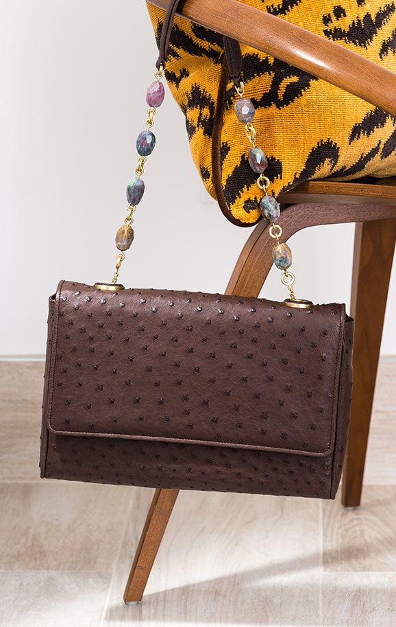 Darby Scott Chain & Jewel handbag on chair