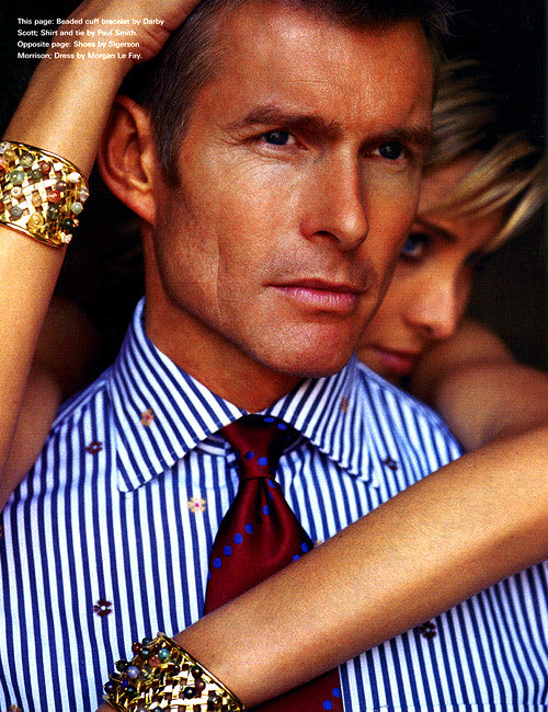 male model with female model hugging him - she wears two Darby Scott signature wicker cuff bracelet set with a confetti array of colored semi-preciaous stones
