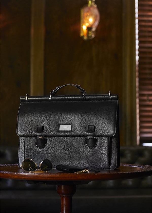 Black leather London Monogram attache on table - Darby Scott