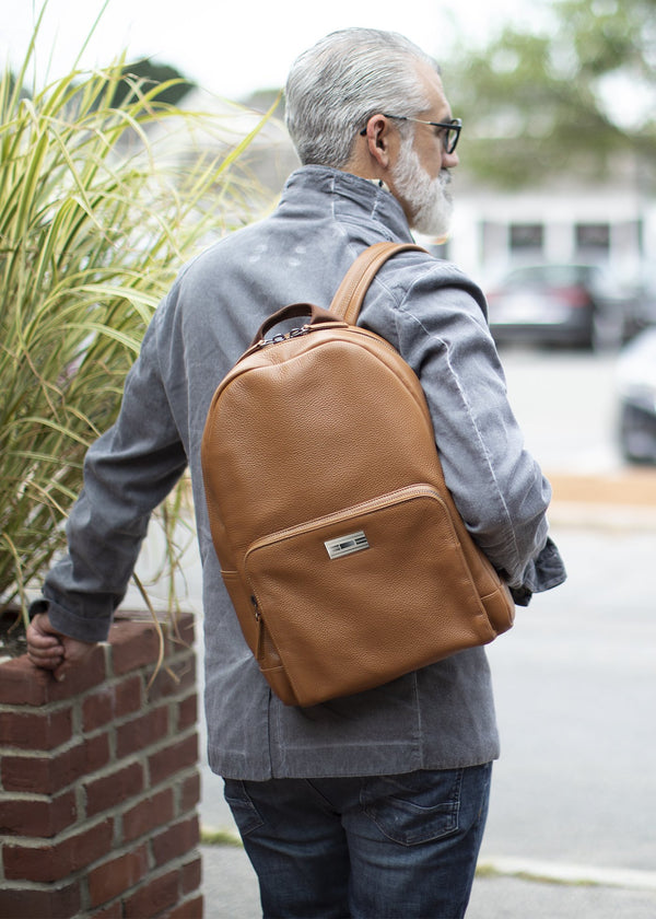 Darby Scott model with cognac leather backpack--alternate