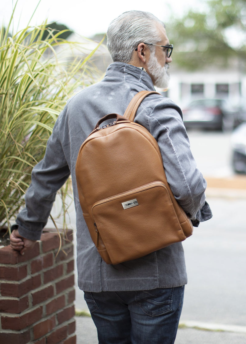 Darby Scott model with cognac leather backpack