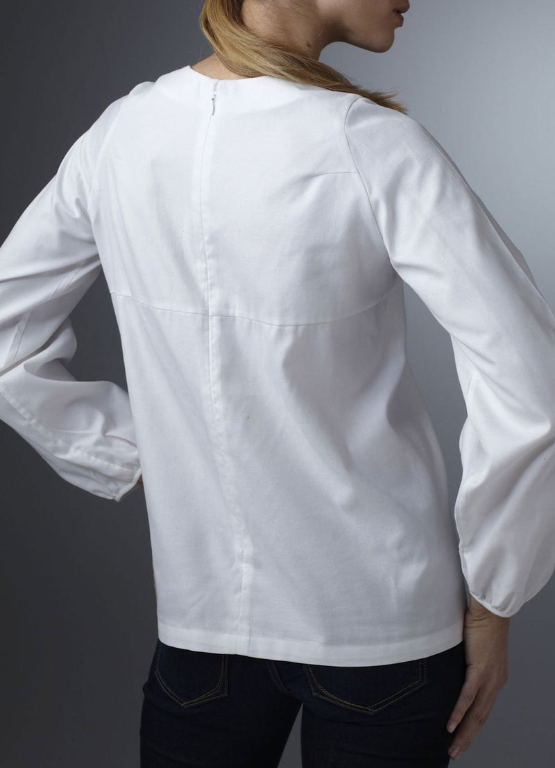 Back view of model in White Cotton Long Sleeve Blouse - Darby Scott