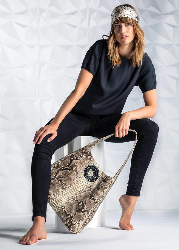 Model  in black silk bateau neck top, tan python hobo handbag, and silk scarf as headband- Darby Scott--alternate