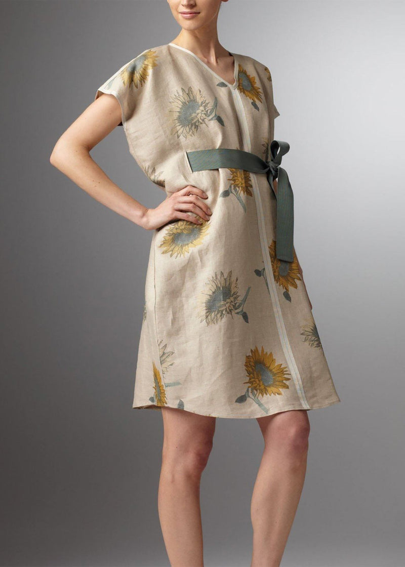Model in Beige French linen with blue sunflowers knee length dress - Darby Scott