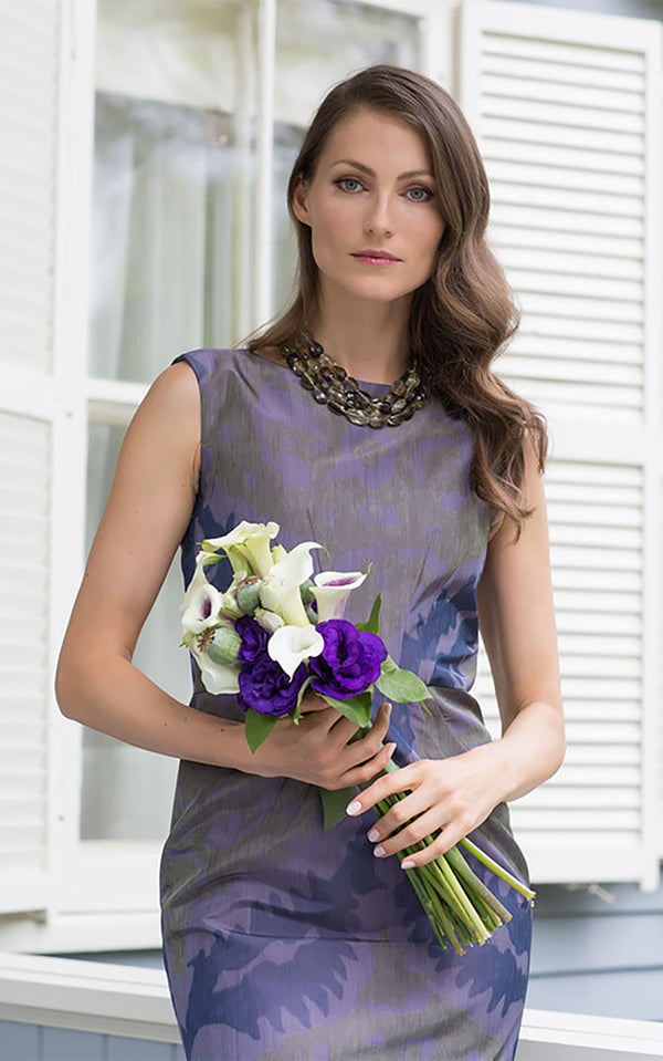 Model holding bouquet of flowers in purple taffeta chemise - Darby Scott--alternate