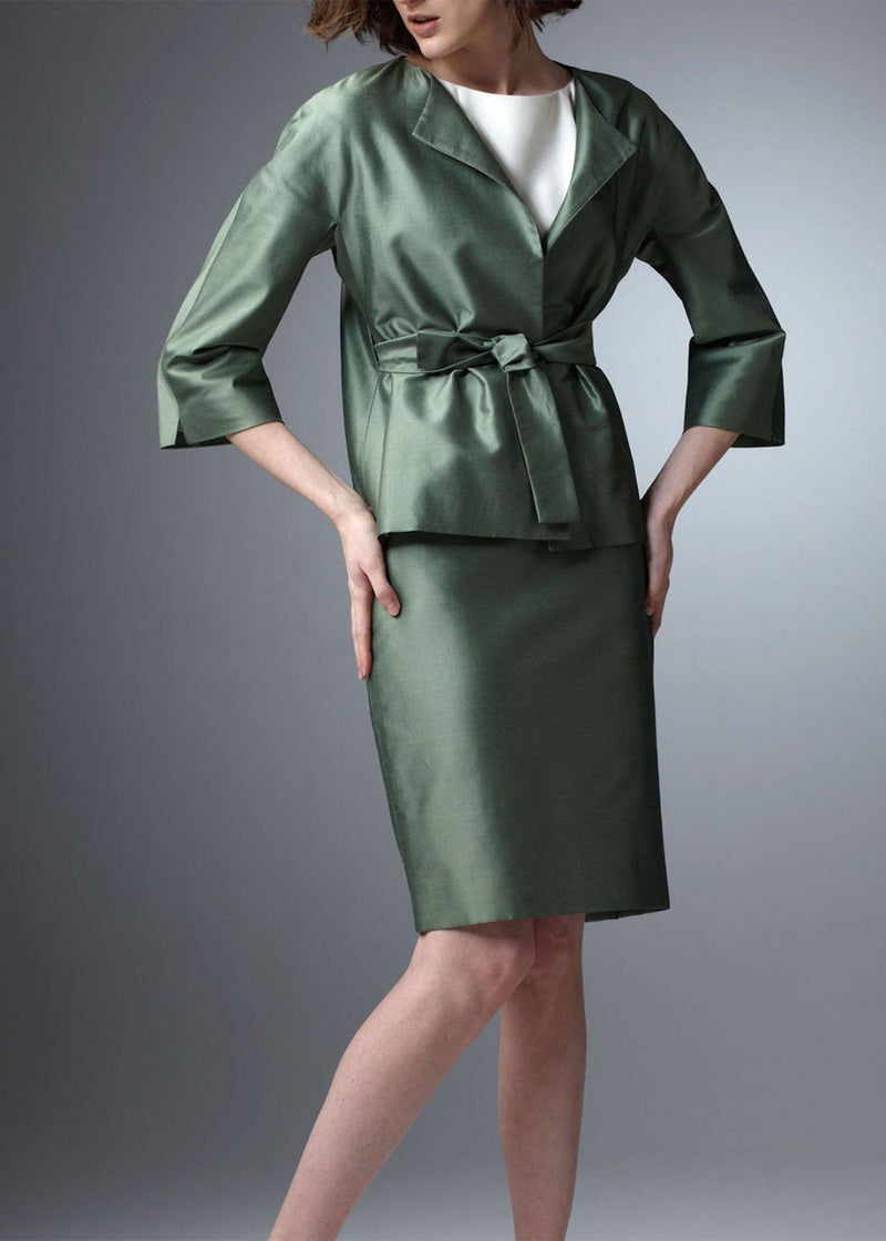 Model in Green silk cotton blend skirt and belted jacket - Darby Scott