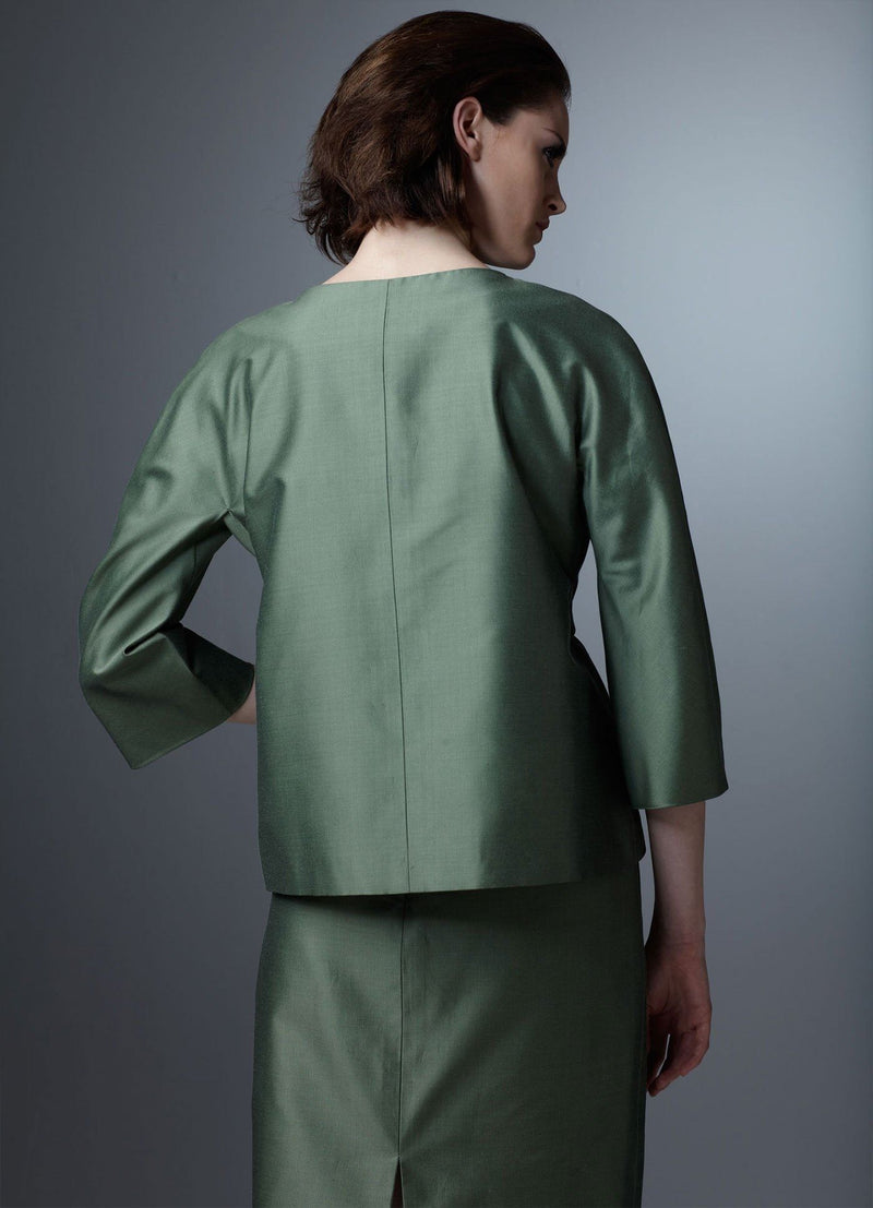 Back view of Green silk cotton blend skirt and belted jacket shown on model - Darby Scott