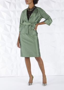 Model in Green silk cotton blend skirt and belted jacket- Darby Scott