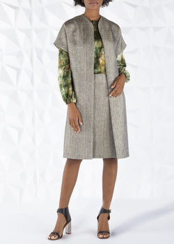 Darby Scott model wearing peppercorn tweed topper coat and pencil skirt.