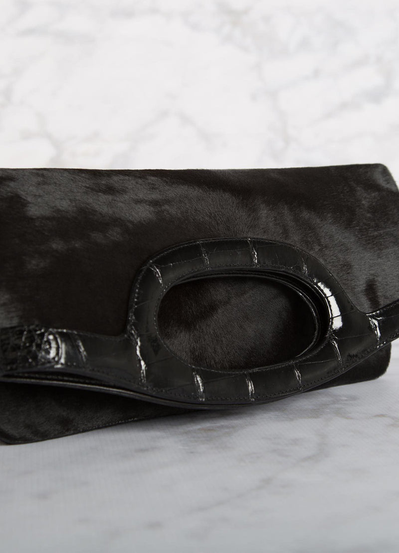 Close up view of handle on Black Haircalf Convertible Clutch - Darby Scott