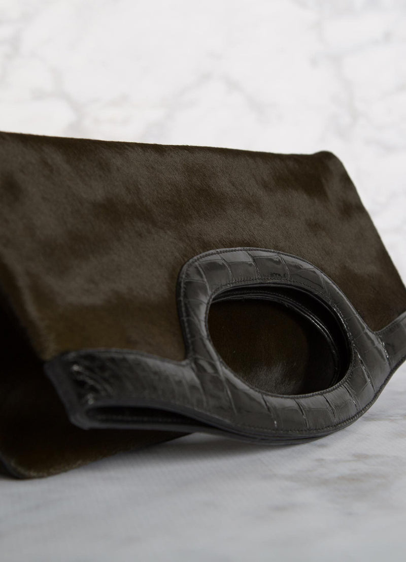 Close up view of handle Olive Haircalf Convertible Clutch - Darby Scott