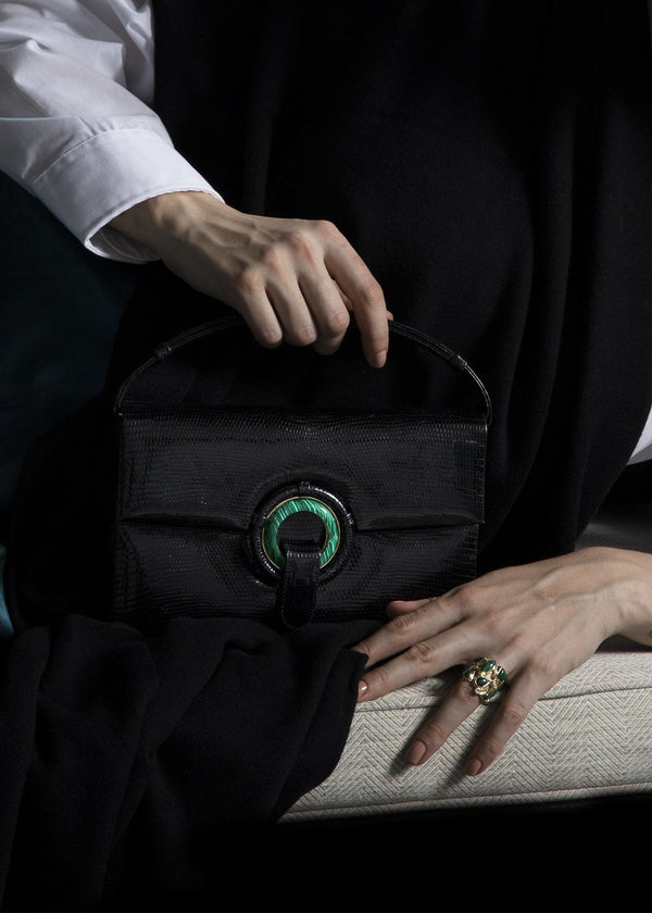 Model with Black Lizard Handbag with Malachite Grommet - Darby Scott  --alternate