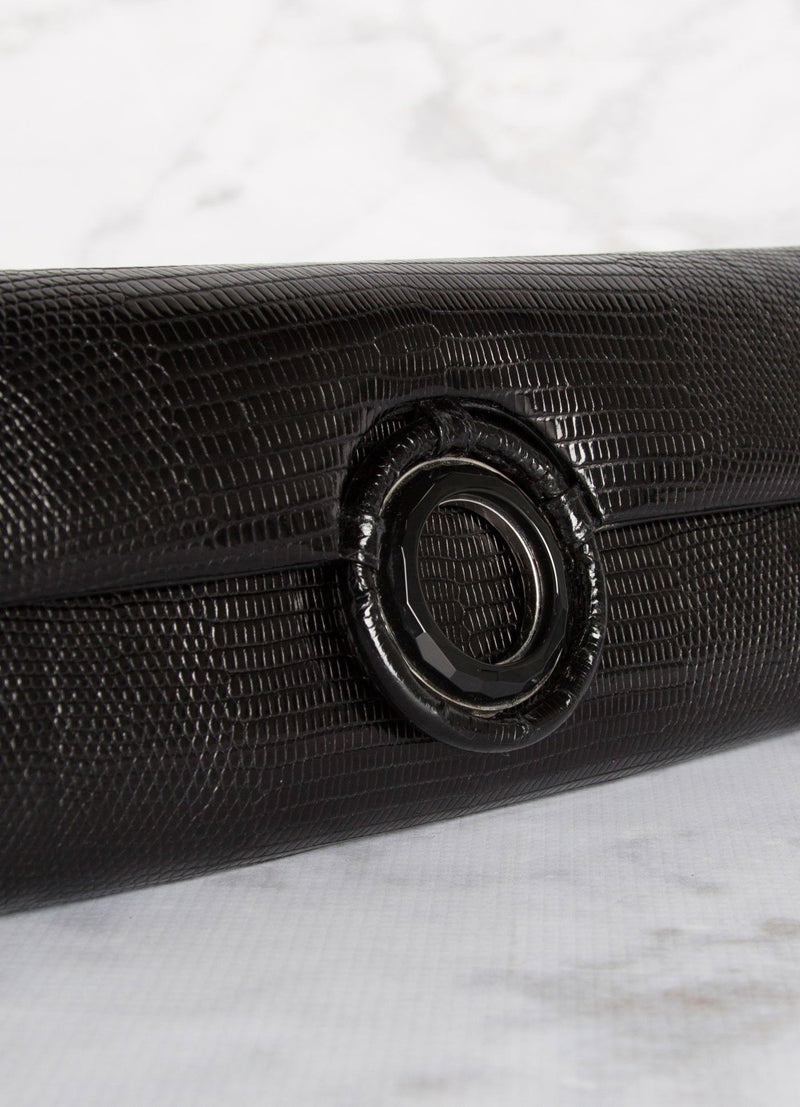 Detail view of Black Onyx Grommet on black lizard clutch - Darby Scott