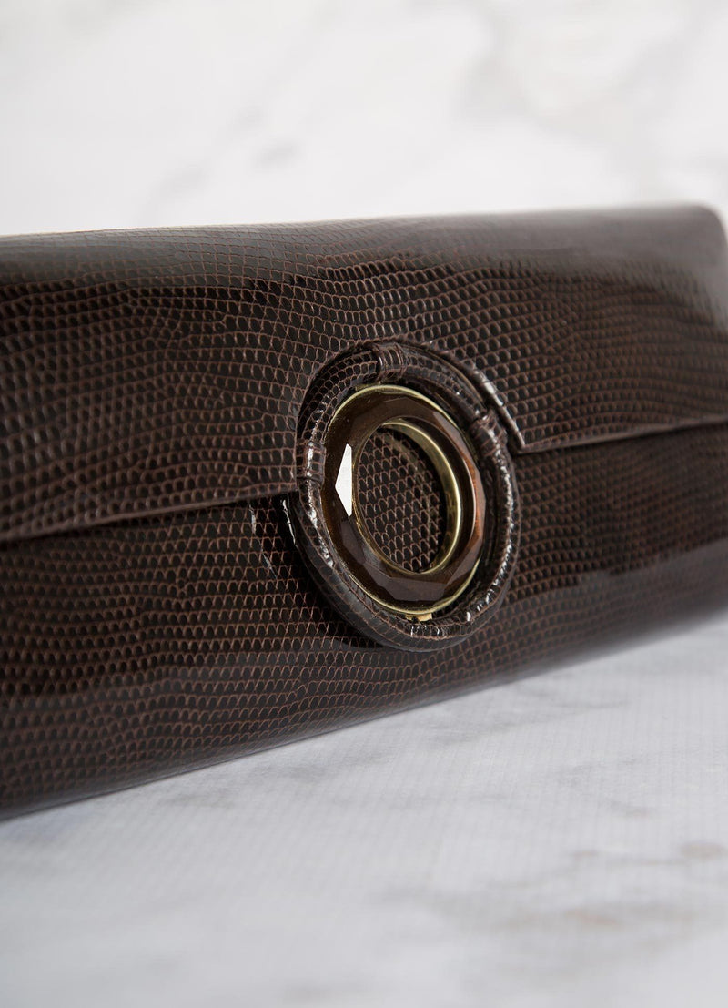 Detail view Smokey Topaz Grommet Inlay on brown lizard roll clutch- Darby Scott