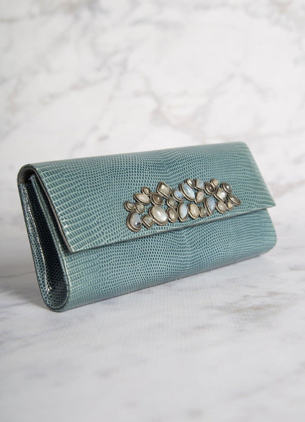 Angled view of Light Blue Lizard Mosaic Roll Clutch with Gemstone Embellishment - Darby Scott--alternate