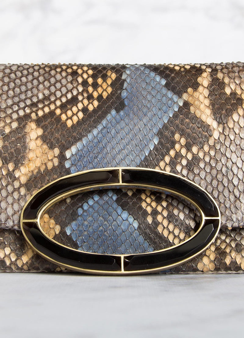 Close up view of smokey topaz handle on Denim blue and brown python clutch- Darby Scott