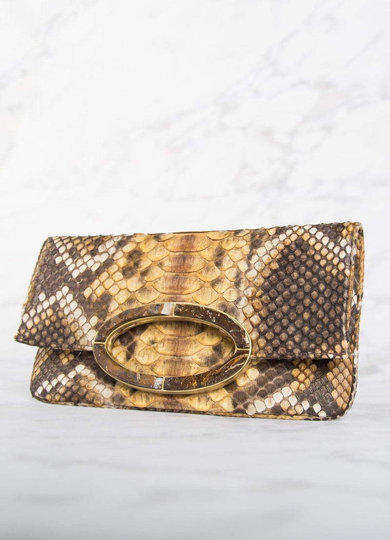 Angled View of Mustard brown Mini Convertible Clutch - Darby Scott