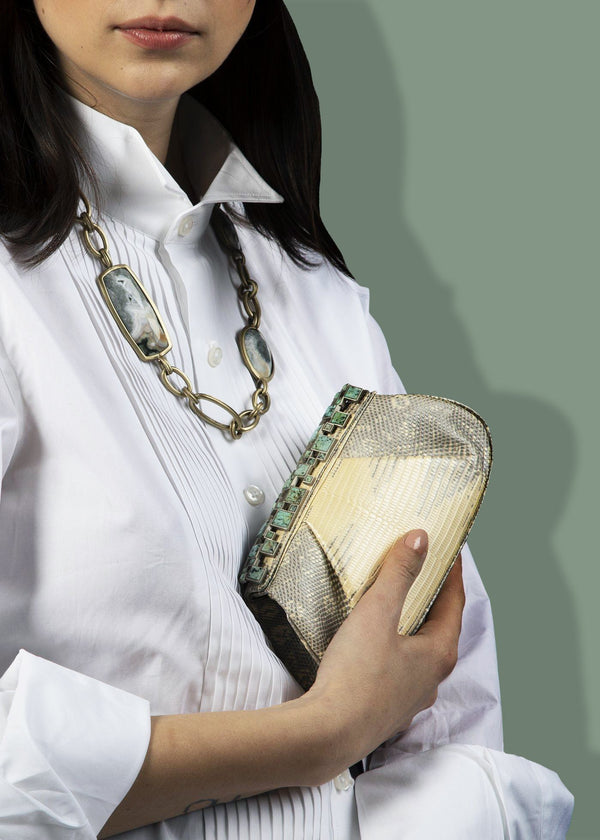 Cream Ring Lizard Clutch with Turquoise held by model- Darby Scott--alternate