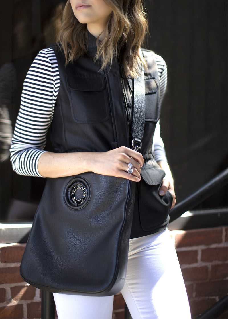 Model in black safari vest and black Cloe Crossbody bag - Darby Scott