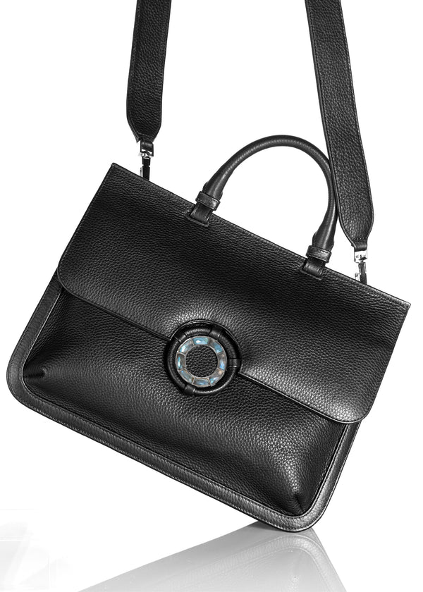 Crossbody strap attached to black leather top handle grommet saddle bag - Darby Scott