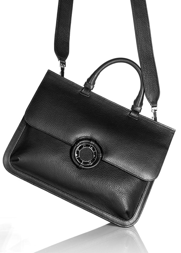 Grommet and Strap detail on black leather grommet saddle bag - Darby Scott