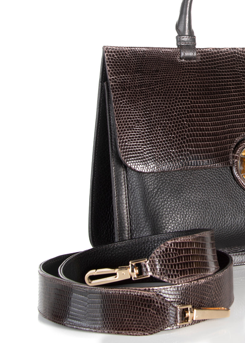 Detail view of crossbody strap and side of brown leather & lizard saddle bag - Darby Scott