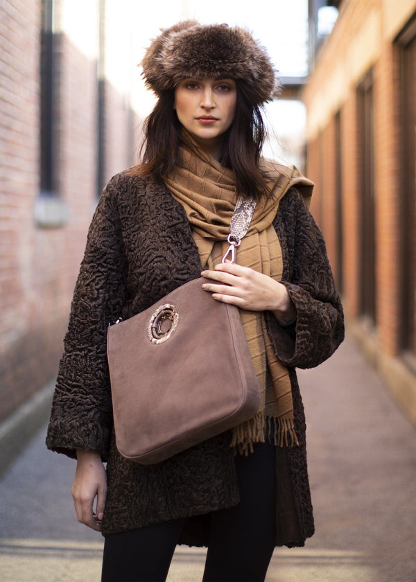 Model carrying a light brown suede Cloe crossbody tote - Darby Scott
