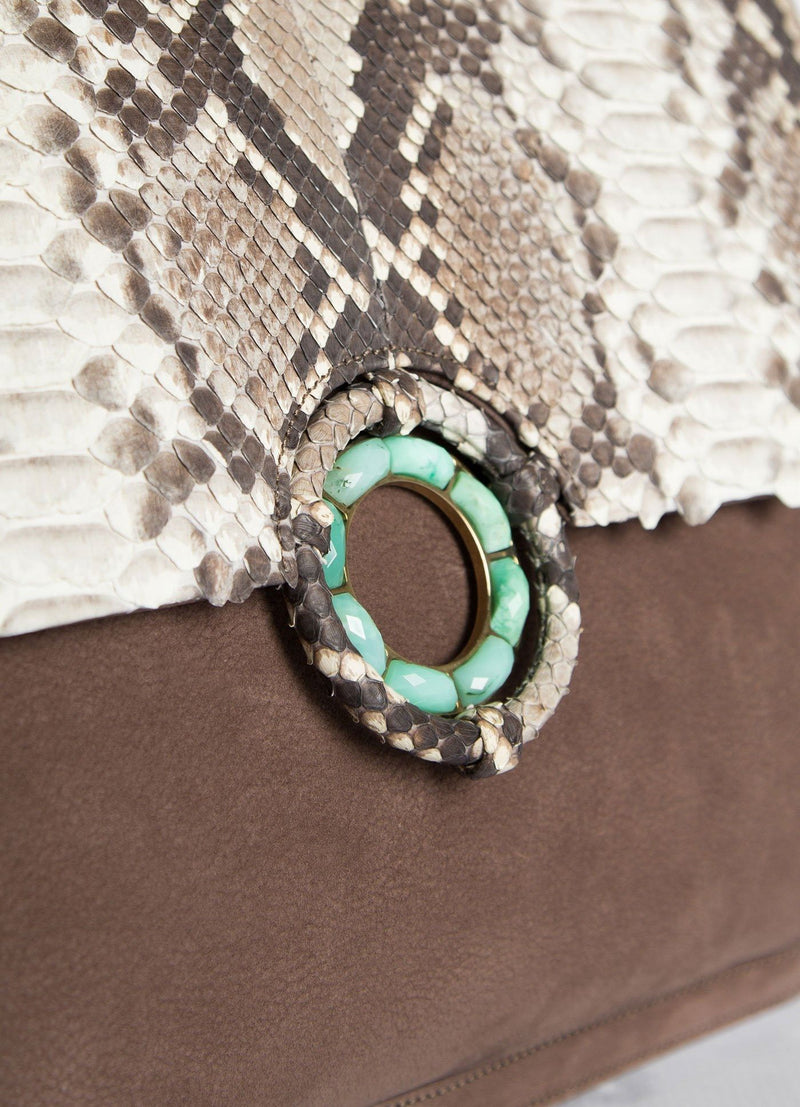 Close up view Chrysoprase Grommet closure on suede Saddle Bag - Darby Scott