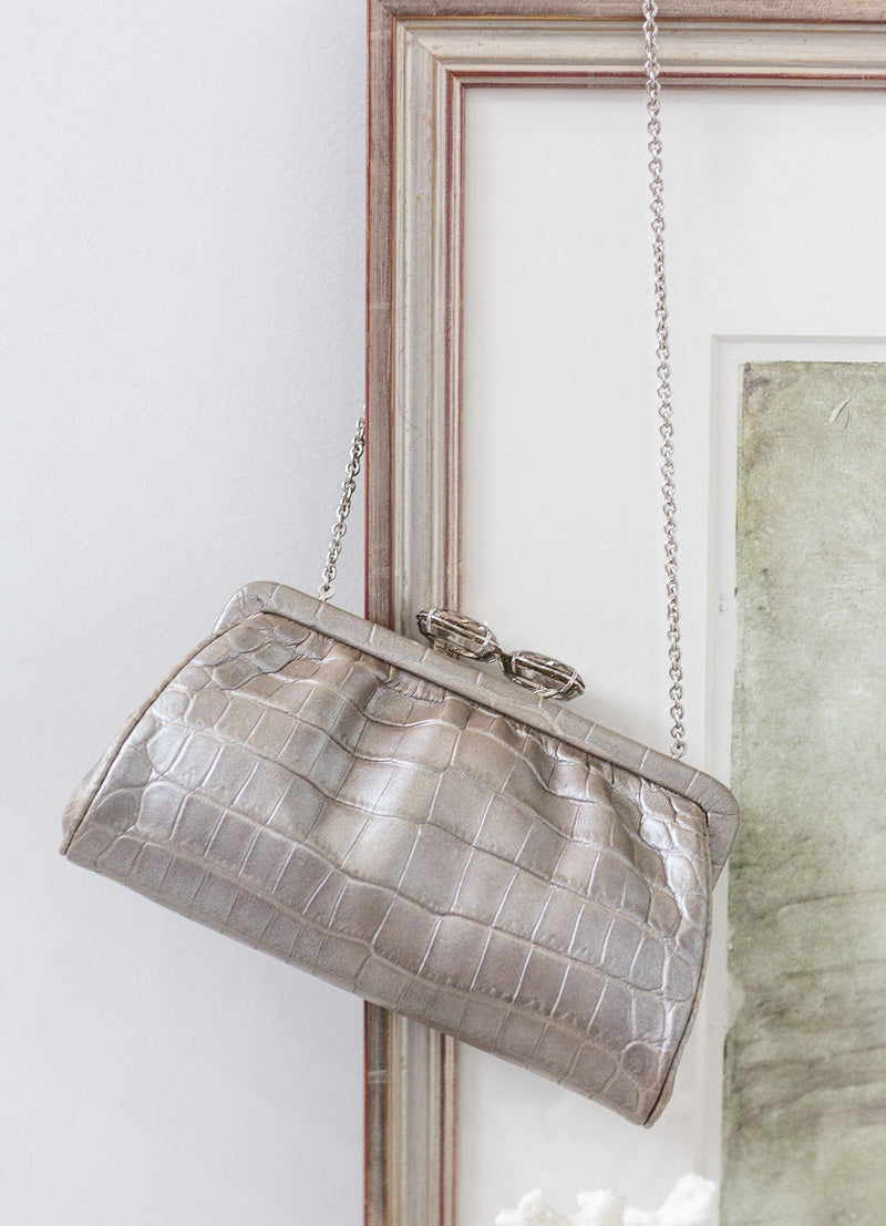 Mercury Crocodile Evening bag hanging on picture - Darby Scott