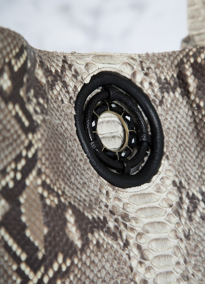 Detail of Black Onyx Grommet on Natural Paige Hobo Tote - Darby Scott