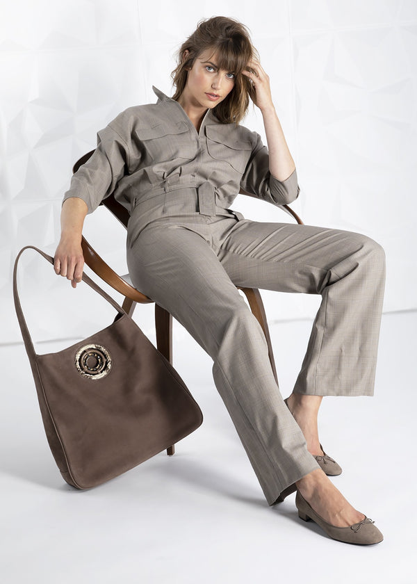 Model in a tan jumpsuit with brown suede Paige Hobo - Darby Scott