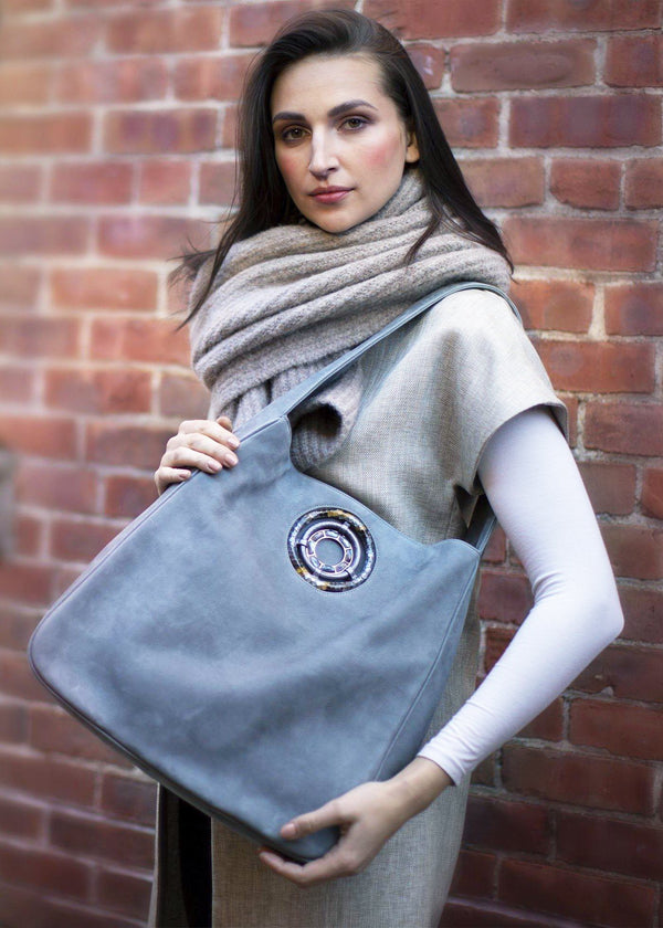 Paige Hobo in Denim Suede held by model - Darby Scott