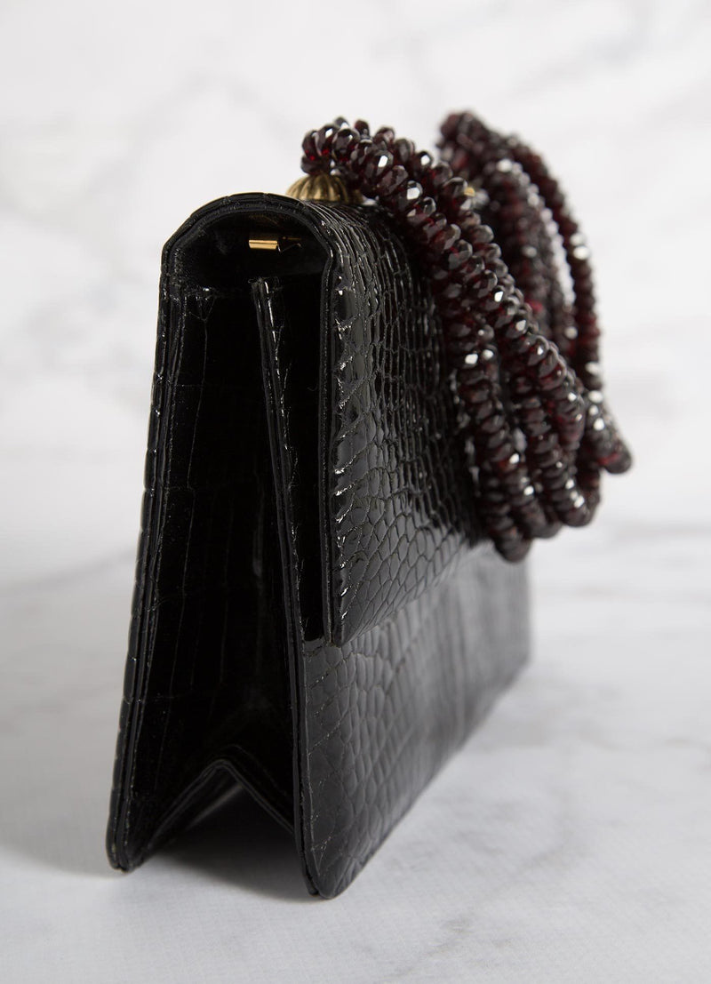 Side view of Black Crocodile and Garnet Necklace Handbag - Darby Scott