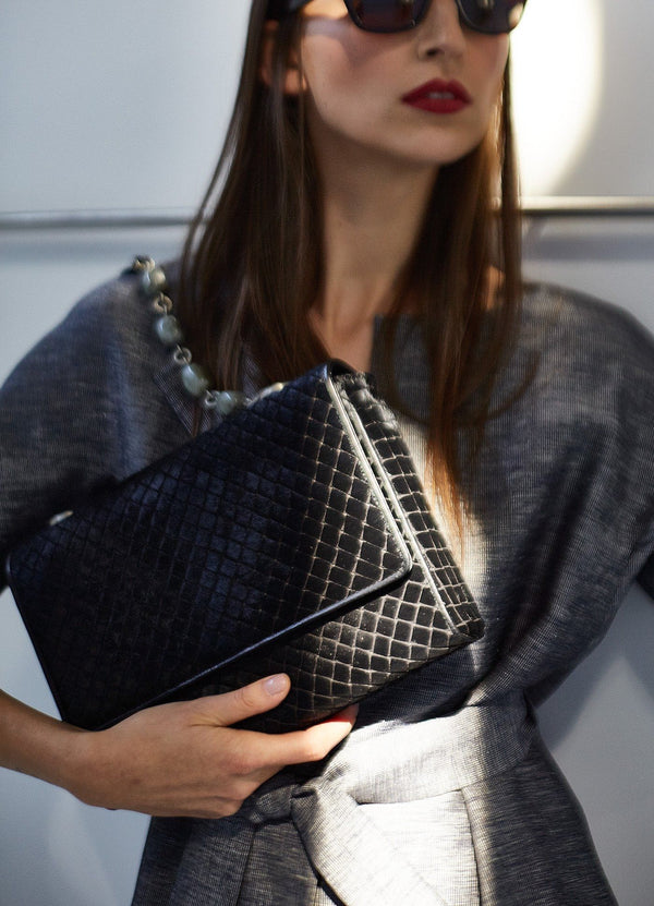 Model holding Black Embossed Haircalf Chain & Jewel Shoulder Bag - Darby Scott
