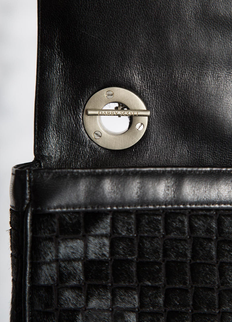 Interior view of handle toggle on black embossed haircalf Shoulder Bag - Darby Scott