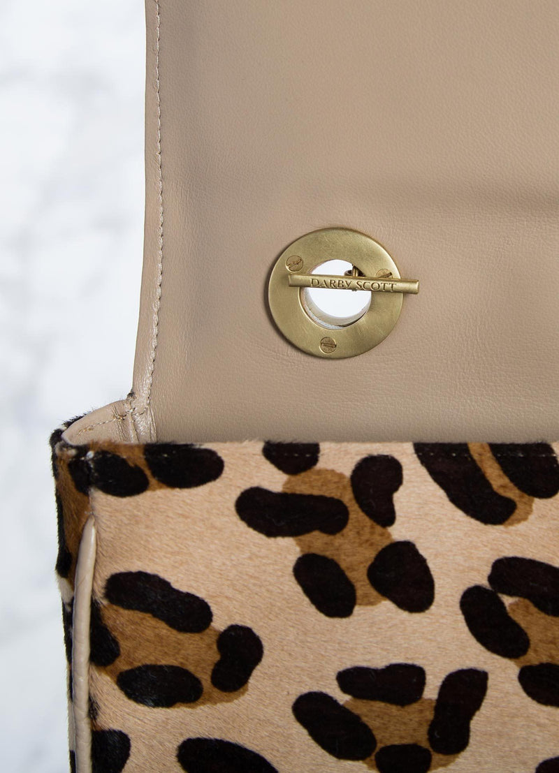 Interior view of handle toggle connector on leopard print shoulder bag - Darby Scott