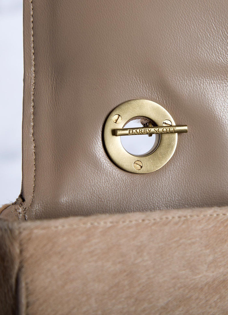 Interior view of handle toggle on tan haircalf Shoulder Bag - Darby Scott