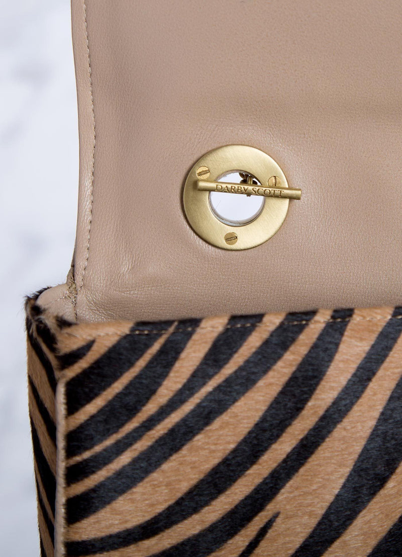 Interior view of handle toggle connector on animal print shoulder bag - Darby Scott