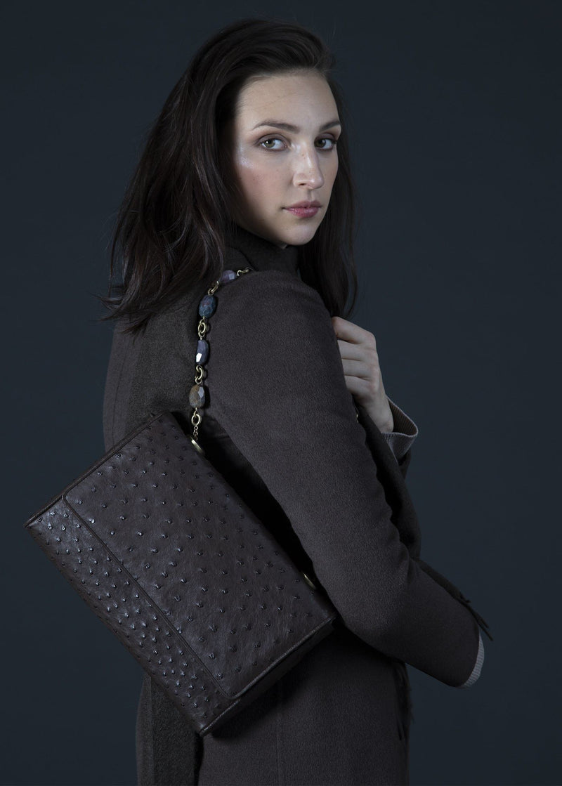 Model with brown ostrich Chain & Jewel Shoulder Bag on her shoulder - Darby Scott
