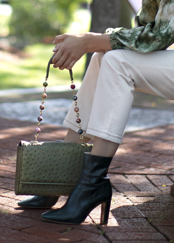 Chain & Jewel Olive Handbag held by Model - Darby Scott