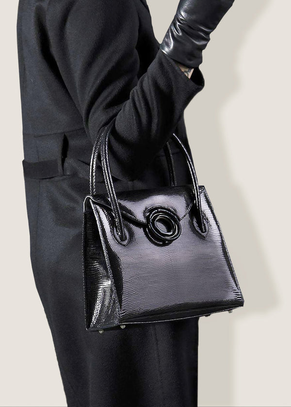 "A Thompson ""O"" Tote in Black Lizard on the arm of a model - Darby Scott--alternate"